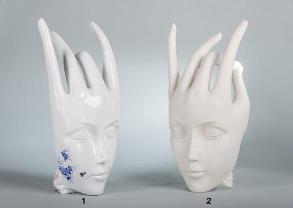 Рука лицо статуэтка